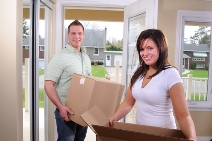 stock-photo-young-attractive-couple-moving-into-their-first-house-12806257