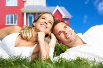 stock-photo-young-love-couple-smiling-dreaming-about-a-new-home-real-estate-concept-29680054