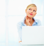 stock-photo-closeup-portrait-of-a-young-woman-using-laptop-with-her-hand-on-neck-24664831