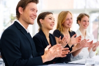 stock-photo-photograph-of-a-european-style-business-team-applauding-3248594
