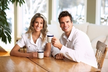 stock-photo-young-love-couple-taking-breakfast-in-the-comfortable-apartment-9973540